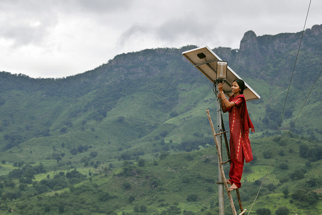 Solar engineer in the solar powered village of Tinginapu