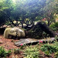 Sculpture of sleeping woman covered in moss in Beacon Hill Park