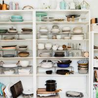 Kitchen shelves with plates, pans and bowls