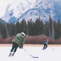 Kids playing hockey on frozen lake in Banff